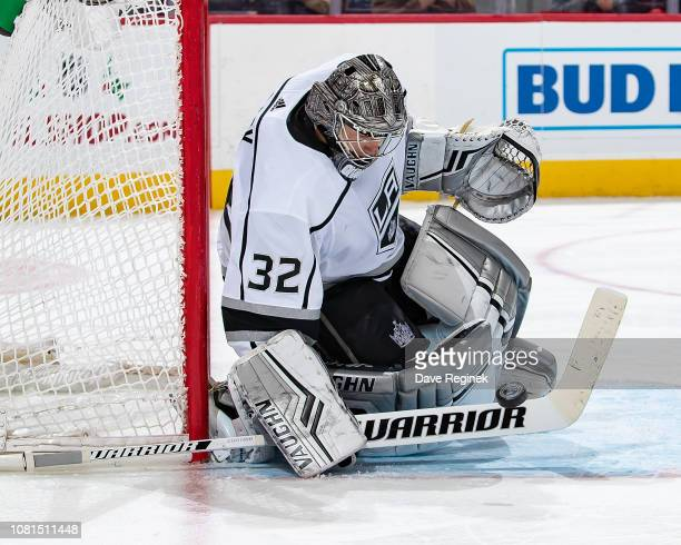 Jonathan Quick of the Los Angeles Kings makes a save against the Detroit Red Wings during an NHL game at Little Caesars Arena on December 10 2018 in...