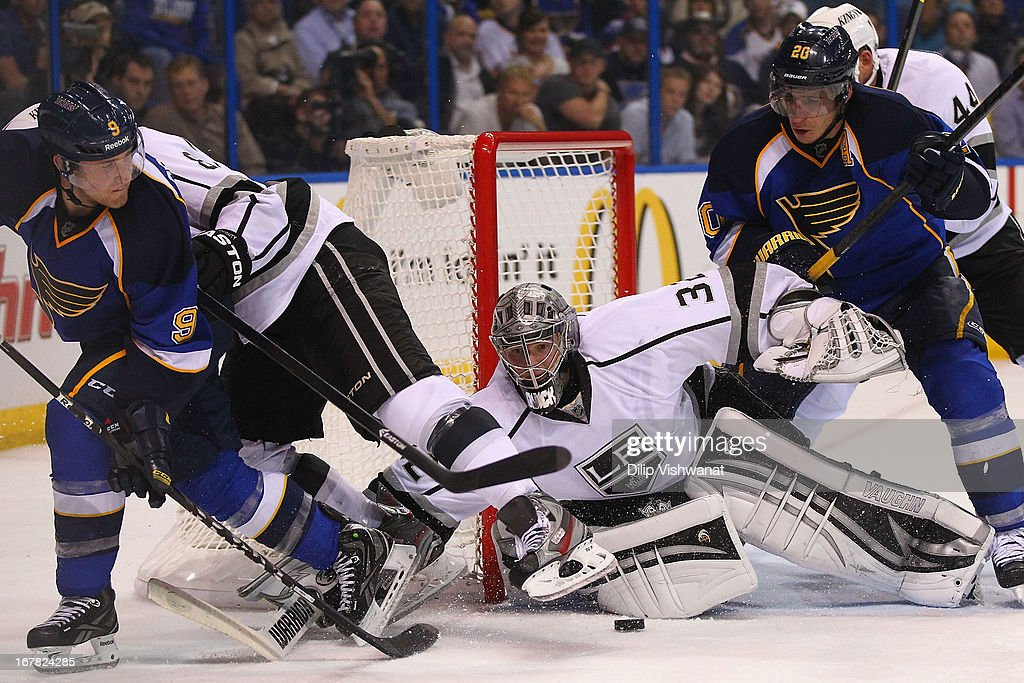 Jonathan Quick #32 of the Los Angeles Kings makes a save against the St. Louis Blues in Game One of the Western Conference Quarterfinals during the 2013 NHL Stanley Cup Playoffs at the Scottrade Center on April 30, 2013 in St. Louis, Missouri. The Blues beat the Kings 2-1 in overtime.