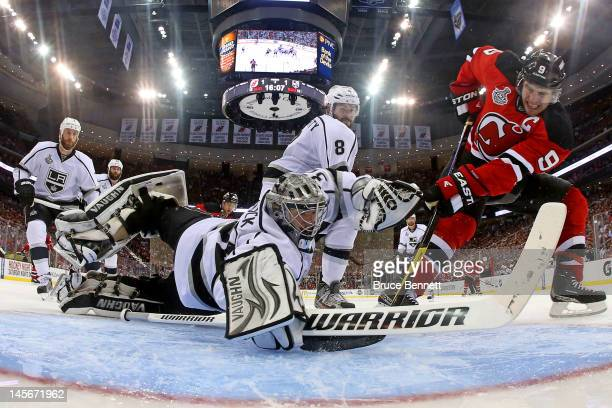 Jonathan Quick of the Los Angeles Kings makes a save against Zach Parise of the New Jersey Devils during Game One of the 2012 NHL Stanley Cup Final...