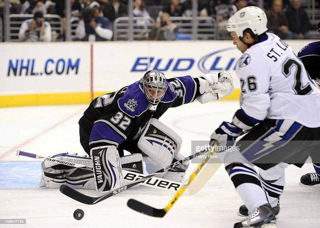 Jonathan Quick #32 of the Los Angeles Kings makes a save as Martin St. Louis #26 of the Tampa Bay Lightning skates in for a rebound during the first period at Staples Center on November 4, 2010 in Los Angeles, California.