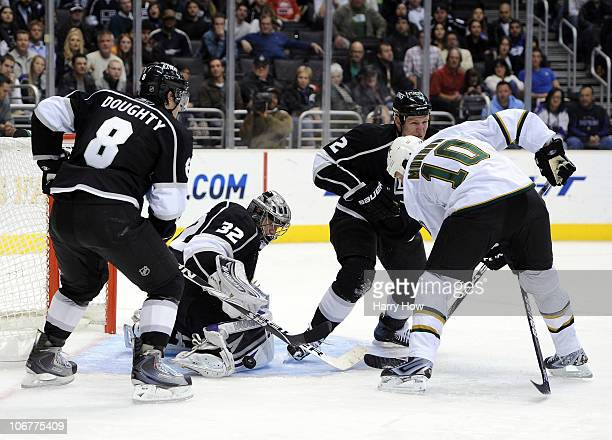 Jonathan Quick of the Los Angeles Kings makes a save as teammates Drew Doughty and Matt Greene look for a rebound along with Brenden Morrow of the...