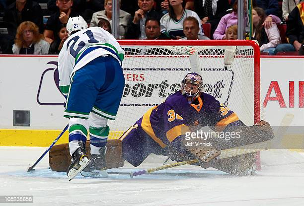 Jonathan Quick of the Los Angeles Kings makes a save off the shot of Mason Raymond of the Vancouver Canucks during their NHL game at Rogers Arena on...