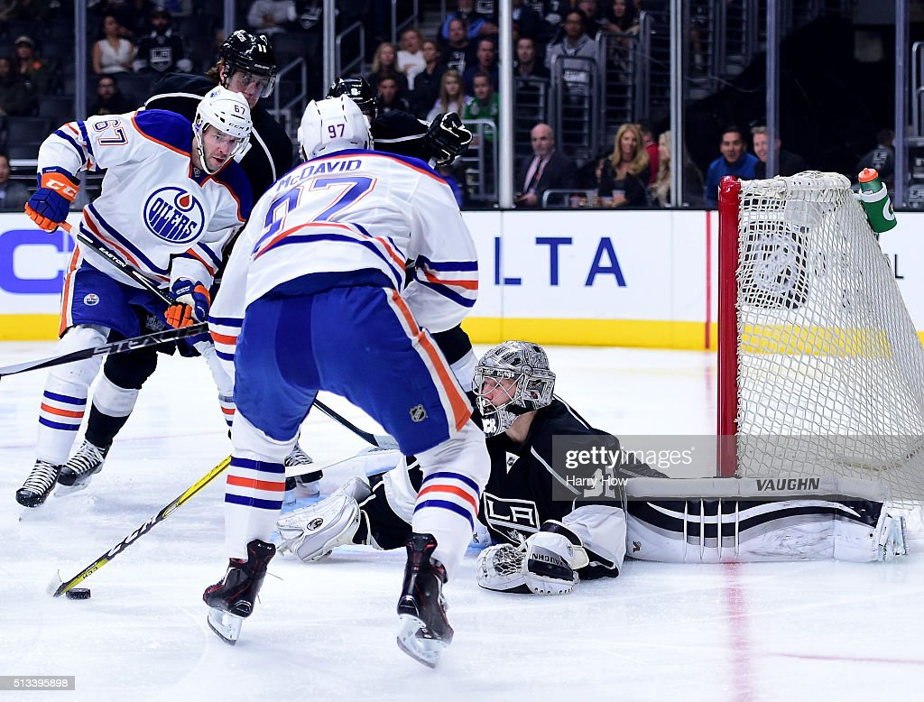 Jonathan Quick #32 of the Los Angeles Kings makes a save on a shot from Connor McDavid #97 of the Edmonton Oilers during the first period at Staples Center on February 25, 2016 in Los Angeles, California.