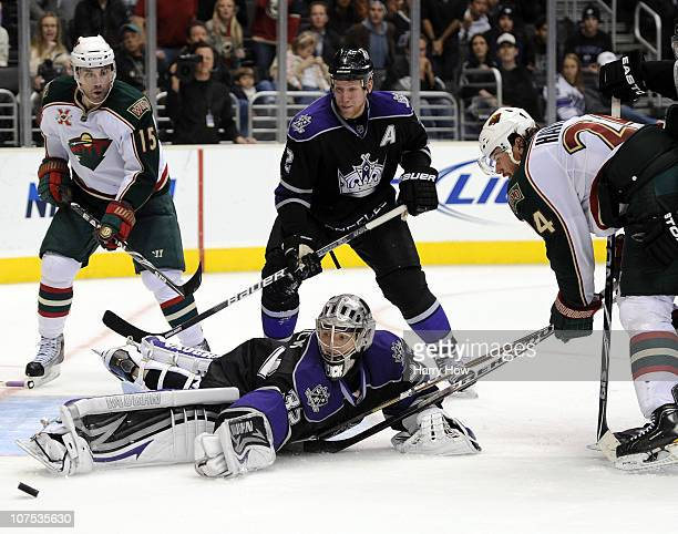 Jonathan Quick of the Los Angeles Kings makes a save on Martin Havlat of the Minnesota Wild as Matt Greene and Andrew Brunette look for a rebound...