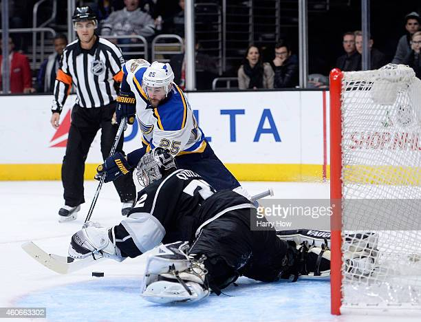 Jonathan Quick of the Los Angeles Kings makes a stop on Chris Butler of the St Louis Blues during the third period at Staples Center on December 18...