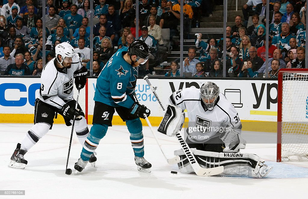 Jonathan Quick #32 of the Los Angeles Kings makes the save against Joe Pavelski #8 of the San Jose Sharks as Drew Doughty #8 of the Los Angeles Kings defends against the shot during the Western Conference First Round during the 2016 NHL Stanley Cup Playoffs at the SAP Center at San Jose on April 20, 2016 in San Jose, California.