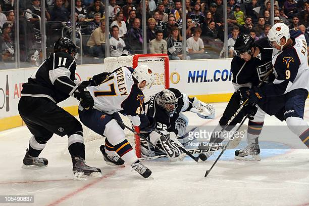 Jonathan Quick of the Los Angeles Kings makes the save against Rich Peverley of the Atlanta Thrashers at Staples Center on October 12 2010 in Los...