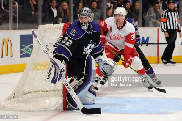 Jonathan Quick of the Los Angeles Kings protects the net against Kris Draper of the Detroit Red Wings on January 7, 2010 at Staples Center in Los...