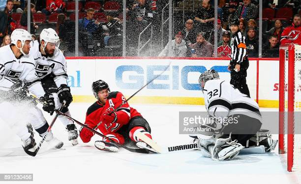 Jonathan Quick of the Los Angeles Kings stops a breakaway by Taylor Hall of the New Jersey Devils during the game at Prudential Center on December 12...