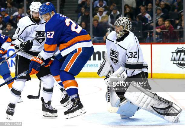 Jonathan Quick of the Los Angeles Kings stops a shot as Anders Lee of the New York Islanders skates on offense during the third period at Barclays...