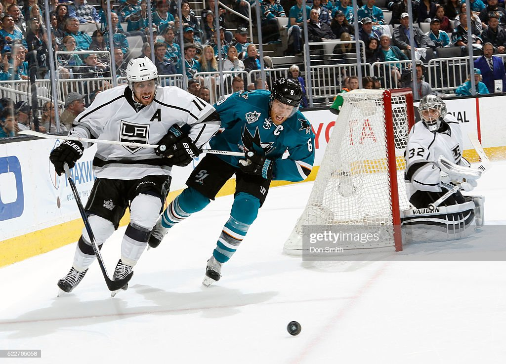 Jonathan Quick #32 of the Los Angeles Kings watches as Joe Pavelski #8 of the San Jose Sharks fights off Anze Kopitar #11 of the Los Angeles Kings for the puck during the Western Conference First Round during the 2016 NHL Stanley Cup Playoffs at the SAP Center at San Jose on April 20, 2016 in San Jose, California.
