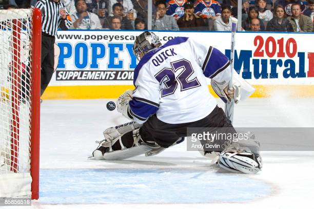 Jonathan Quick of the Los Angeles Kings watches the puck bounce over his arm against the Edmonton Oilers at Rexall Place on April 7 2009 in Edmonton...