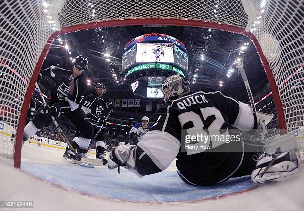 Jonathan Quick Rob Scuderi and Jeff Carter of the Los Angeles Kings look for a rebound with Andy McDonald of the St Louis Blues during a 10 Kings win...