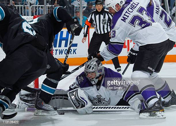 Jonathan Quick, Willie Mitchell and Michal Handzus of the Los Angeles Kings defend the net against the San Jose Sharks in Game 5 of the Western...