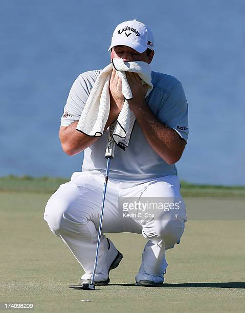 Jonathan Randolph wipes his face prior to putting on the ninth green during the continuation of the second round of the Sanderson Farms Championship...
