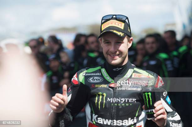 Jonathan Rea of Great Britain and KAWASAKI RACING TEAM celebrates under the podium the victory at the end of the race 1 during the FIM World...