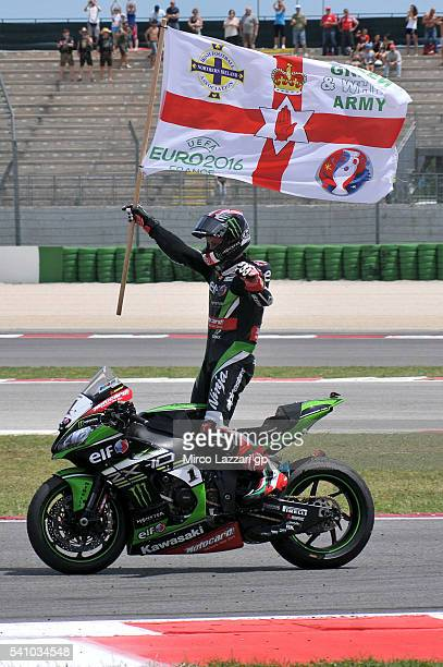 Jonathan Rea of Great Britain and KAWASAKI RACING TEAM celebrates the victory with a flag at the end of the Race 1 during the FIM Superbike World...