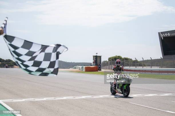 Jonathan Rea of Great Britain and KAWASAKI RACING TEAM WorldSBK cuts the finsih lane and celebrates the victory at the end of the Superbike race 1...