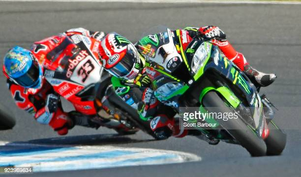 Jonathan Rea of Great Britain and Kawasaki Racing Team WorldSBK leads Marco Melandri of Italy and Arubait Racing Ducati on turn 10 of the final lap...