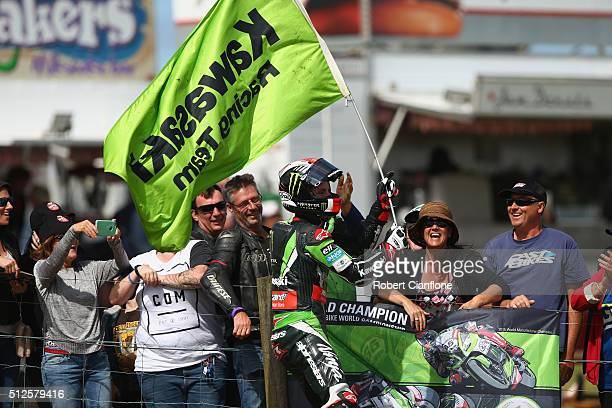 Jonathan Rea of Great Britain and rider of the Kawasaki Racing Team Kawasaki celebrates with fans after winning race one of round one of the 2016...