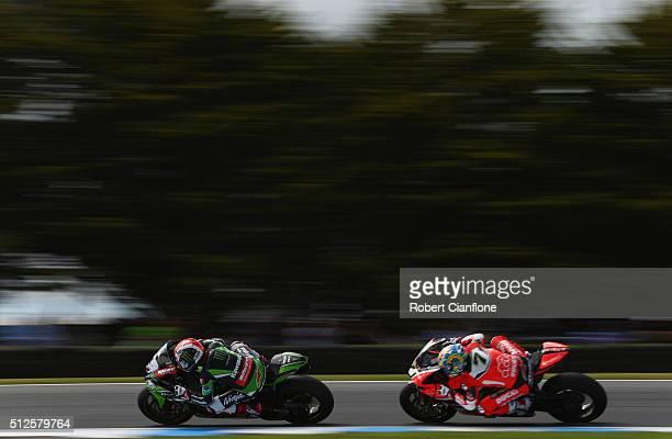 Jonathan Rea of Great Britain riding the Kawasaki Racing Team Kawasaki is chased by Chaz Davies of Great Britain riding the Arubait Racing Ducati...