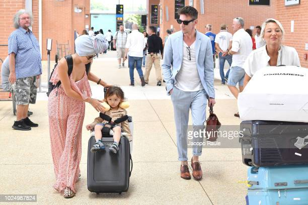 Jonathan Rhys Meyers, Mara Lane and their son Wolf Rhys Meyers are seen arriving at Venice Airport during the 75th Venice Film Festival on August 29,...