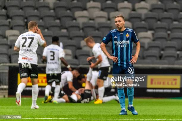 Jonathan Ring of Djurgardens IF is dejected as players from Orebro SK celebrate their 2-1 goal with during an Allsvenskan match between Djurgardens...