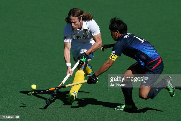 Jonathan Robinson of South Africa and Manabu Yamashita of Japan battle for possession during the 9th/10th place play off match between Japan and...