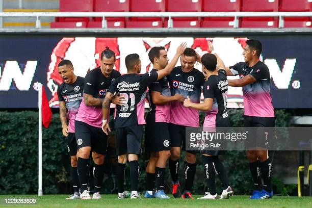 Jonathan Rodríguez of Cruz Azul celebrates with his teammates after scoring the first goal of his team during the 15th round match between Chivas and...
