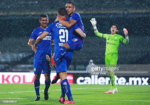 Jonathan Rodriguez of Cruz Azul celebrates with teammates after scoring the first goal of his team during the 1st round match between Cruz Azul and...