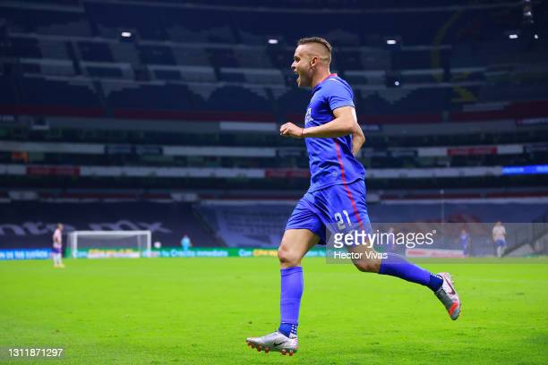Jonathan Rodriguez of Cruz Azul celebrates with teammates after scoring the first goal of his team during the 14th round match between Cruz Azul and...
