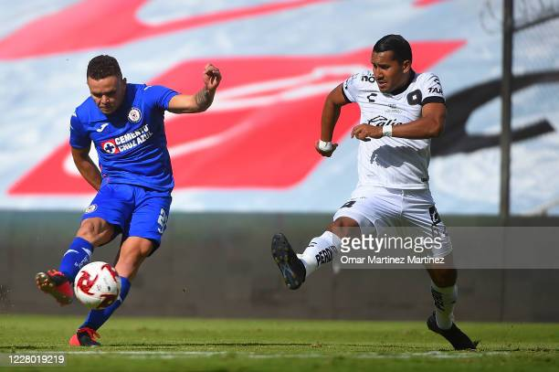 Jonathan Rodriguez of Cruz Azul fights for the ball with Alfonso Luna of Queretaro during the 4th round match between Queretaro and Cruz Azul as part...
