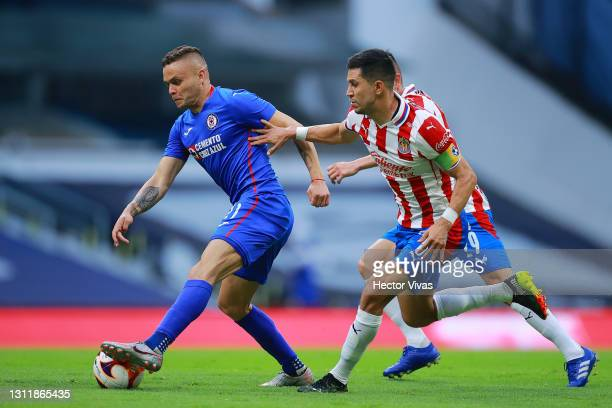 Jonathan Rodriguez of Cruz Azul struggles for the ball against Jesus Molina of Chivas during the 14th round match between Cruz Azul and Chivas as...