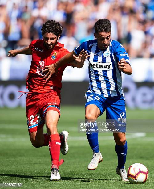 Jonathan Rodriguez of Deportivo Alaves duels for the ball with Esteban Felix Granero of RCD Espanyol during the La Liga match between Deportivo...