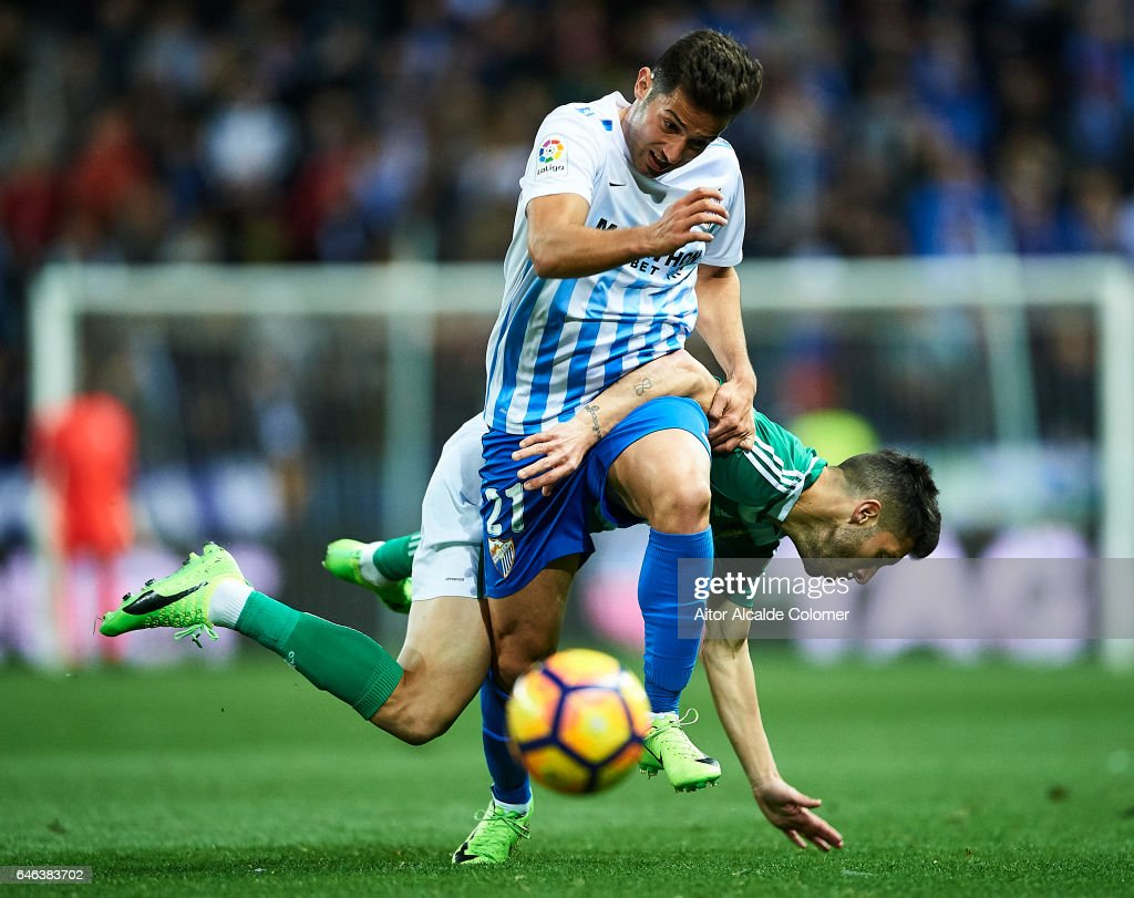 Jonathan Rodriguez of Malaga CF (L) competes for the ball with Alvaro Cejudo of Real Betis Balompie (R) during La Liga match between Malaga CF and Real Betis Balompie at La Rosaleda Stadium February 28, 2017 in Malaga, Spain.