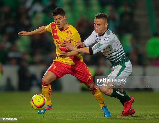 Jonathan Rodriguez of Santos and Adrian Lezcano of Morelia fight for the ball during the 3rd round match between Santos Laguna and Morelia as part of...