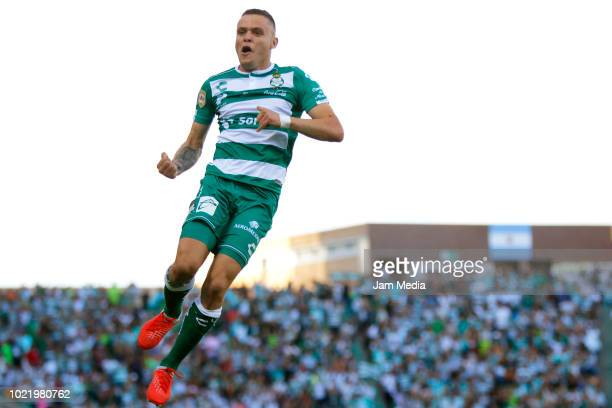 Julio Furch of Santos celebrates with teammates after scoring the first goal of his team during the fifth round match between Santos Laguna and...