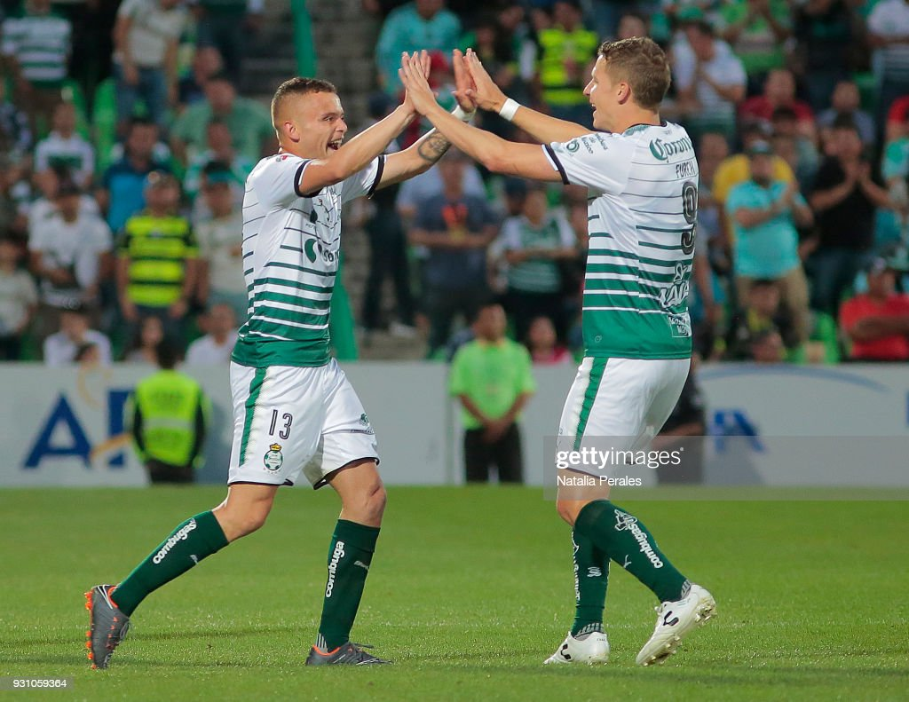 Jonathan Rodriguez of Santos celebrates with teammate Julio Furch after scoring the third goal of his team during the 11th round match between Santos Laguna and Monterrey as part of the Torneo Clausura 2018 Liga MX at Corona Stadium on March 11, 2018 in Torreon, Mexico.