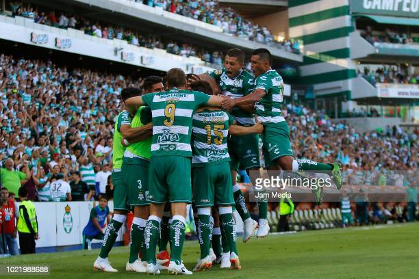 Jonathan Rodriguez of Santos celebrates with teammates after scoring the third goal of his team during the fifth round match between Santos Laguna...