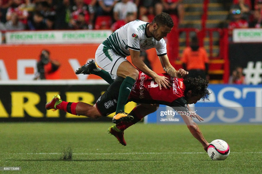 Jonathan Rodriguez (L) of Santos Laguna and Matias Aguirregaray (R) of Tijuana compete for the ball during the fifth round match between Tijuana and Santos Laguna as part of the Torneo Apertura 2017 Liga MX at Caliente Stadium on August 18, 2017 in Tijuana, Mexico.