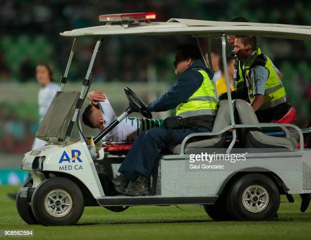 Jonathan Rodriguez of Santos leaves the field after being injured during the 3rd round match between Santos Laguna and Morelia as part of the Torneo...