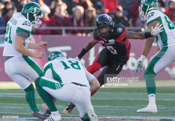 Jonathan Rose of the Ottawa Redblacks tries to block a field goal attempt by Tyler Crapigna of the Saskatchewan Roughriders in Canadian Football...
