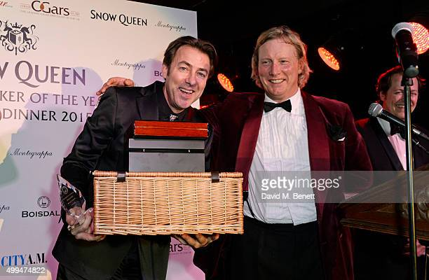 Jonathan Ross accepts the The Snow Queen Cigar Smoker of the Year award from Ranald Macdonald at The Snow Queen Cigar Smoker of the Year Awards...