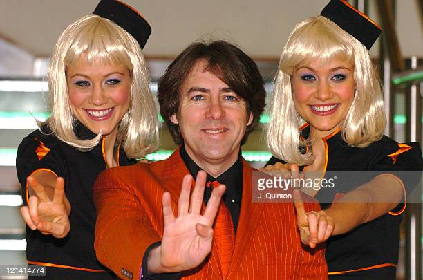 """Jonathan Ross and Orange Movie Girls during Jonathan Ross Launches """"Orange Wednesday's"""" Movie Ticket Promotion at The Odeon Leicester Square in..."""