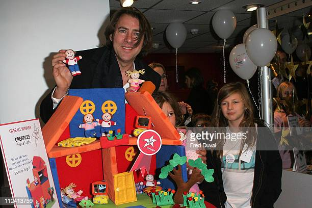 Jonathan Ross judge of award with children Honey Ross and Harvey Ross with the winning toy creAtiles