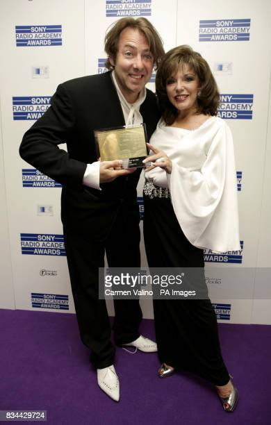 Jonathan Ross with the Music Radio Personality Award presented by Joan Collins during the Sony Radio Academy Awards at the Grosvenor House Hotel in...