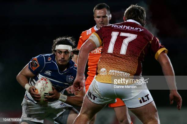 Jonathan Ruru of Auckland is challenged by Joseph Walsh of Southland during the round nine Mitre 10 Cup match between Southland and Auckland at Rugby...