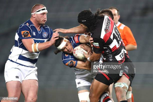 Jonathan Ruru of Auckland is takled by Latiume Fosita of Counties during the round one Mitre 10 Cup match between Auckland and Counties Manukau at...
