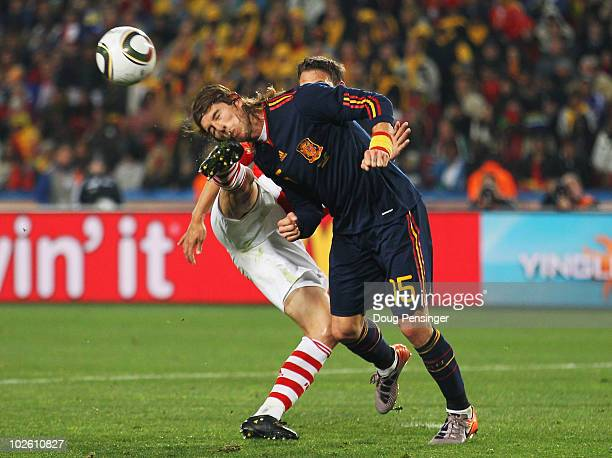 Jonathan Santana of Paraguay kicks Sergio Ramos in the head during the 2010 FIFA World Cup South Africa Quarter Final match between Paraguay and...