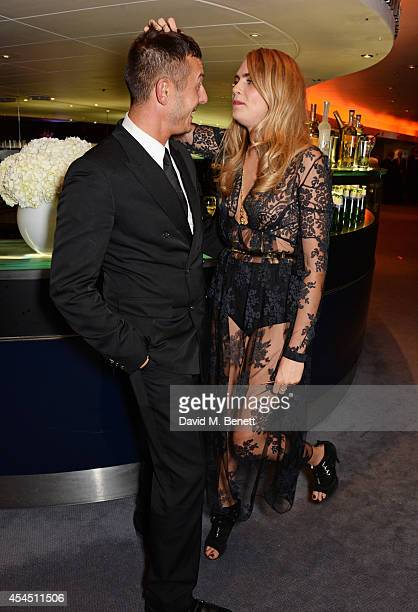 Jonathan Saunders and Cara Delevingne attend the GQ Men Of The Year awards in association with Hugo Boss at The Royal Opera House on September 2,...